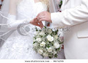 stock-photo-a-groom-puts-on-a-wedding-ring-to-the-finger-of-the-bride-9875299.jpg
